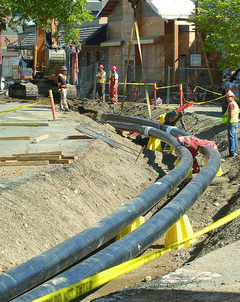 Work on the downtown district energy system continues as City of Prince George crews along with contractors put the pipe in the ground down George Street. Citizen photo by Brent Braaten