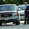 An RCMP constable investigates a pickup damaged by a suspect who attempted to break in at 9 a.m. Tuesday on Ross Crescent. The suspect fled the area,  with police in search. Sept 07. 2011 Citizen photo by David Mah