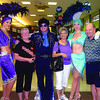 Showgirls and Elvis greeted passengers Nancy Croft, left, Nancy Thurier, Dave Croft, and other passengers for the inaugural flight to Las Vegas Saturday. Westjet is putting on the flights. Sept, 12, 2011. Citizen photo by David Mah
