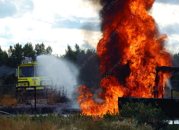 Prince George Airport Authority Airport Operation Specialists were taking recurrent training with aircraft engine fire simulation. Training involved turrett training from a pumper truck Friday afternoon. Citizen photo by Brent Braaten     Sept 16 2011
