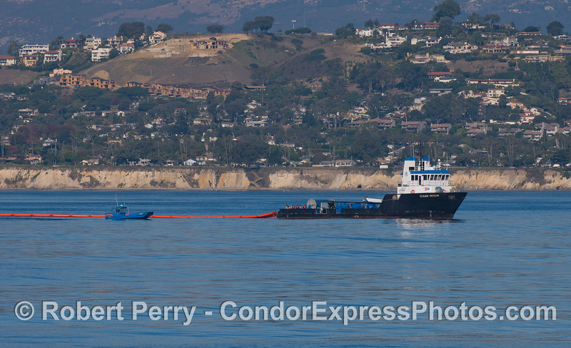 "The oil spill response vessel ""Clean Seas"" deploys a containment buoy as part of a practice drill off the coast of Santa Barbara."