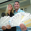 Kali and Brent Marshall with the 100 tickets purchased by Northland Auto Group from the Hospice Dream Home lottery. Citizen photo by Brent Braaten      Oct 6 2011