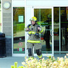 A City of Prince George firefighter exits the TD Canada Trust in college Heights Thursday afternoon. The fire department was called to the bank because of smoke inside. Staff evacuated as the cause of the smoke was investigated. Citizen photo by brent Braaten    Oct 6 2011