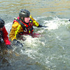 Members of the Prince George Fire/Rescue Department  were taking a two-day Swift Water Rescue course in the Nechako River. Captain Larry Obst, left, and firefighter Ben Williams, right, watch as firefighter Gerry Rodgerson frees himself from having a foot trapped in rocks in the Nechako River. Citizen photo by Brent Braaten     Sept 6 2011