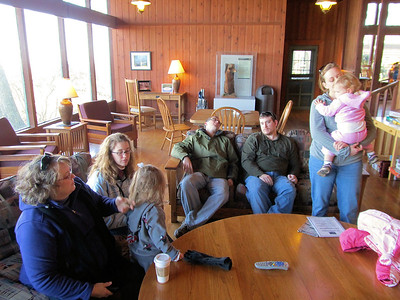 Deb, Aubrey, Carrie, Joe, Jesse, Julie and Brynn, in front of the fire place, warming up.