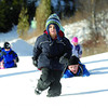 Ryder Green, 5, leads the way as the Tiny Y Pre-School group trudge through the snow on beside Massey Drive on their way to slidding at Carney Hill. Citizen photo by Brent Braaten      Nov 22 2011