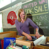 Diana Kutzner sorts out book during the United Way Book Sale at UNBC to raise funds for the United Way. The sale is on today and Thursday between 9 -4:30 by the Canfor Wintergarden. UNBC has raised $25,500 which is 70 percent of what they want to raise, the hope is that the book sale will get them closer to the goal of $30,000 for the United Way. Citizen photo by Brent Braaten     Nov 22 2011