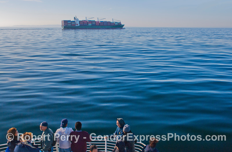 Passengers aboard the Condor Express get a first hand look at the container vessel Hugo Schulte.