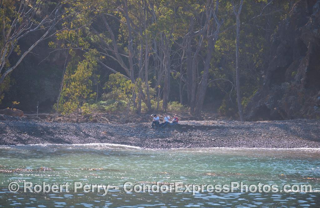 Sta Cruz Island - People on beach, Little Pelican.
