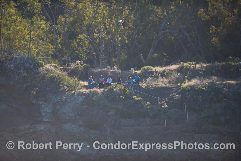Sta Cruz Island - People at old hotel site, Pelican Bay.