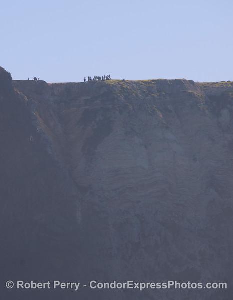Hikers on cliff top - Sta Cruz Island.