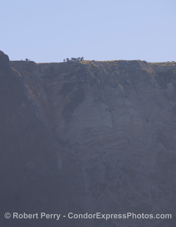 Hikers on cliff top - Sta Cruz Island.