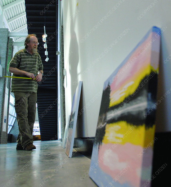 Ken Turner assistant curator/exhibition technician installs an exhibit in the Rustad Galleria Tuesday morning. The exhibit titled Across Canada featuring work by Kathryn Rohl and Lorraine Young. The exhibit opens on Thursday evening with an artists talk and will be up until January 15. Citizen photo by Brent Braaten      Dec 6 2011