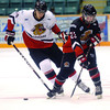 Cariboo Cougars alumni player Dan Gibb left and Cariboo Cougars Hayden-James Berra both look for the puck during the Alumni Game Friday at CN Centre. Citizen photo by Brent Braaten Dec 23 2011