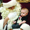Charlie Duckworth, 3 months has a visit with Santa at Pine Centre Mall Fiday afternoon. Santa was busy with children putting in their last minute requests. Citizen photo by Brent Braaten    Dec 23 2011