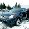 Citizen photo by Chuck Nisbett Northland Nissan sales representative Shelly Fraser with the 2012 Nissan Rogue SL.
