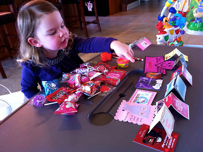 Anna counting the valentines she got from her class