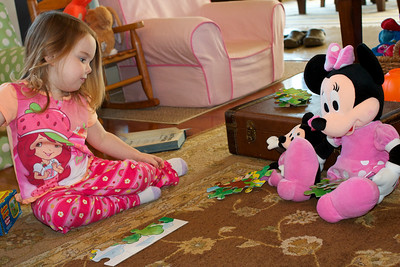 """Minnie Mouse was helping Anna with her puzzle.  Minnie Mouse gets the """"not flat"""" pieces."""