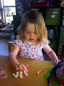Carefully counting her candies