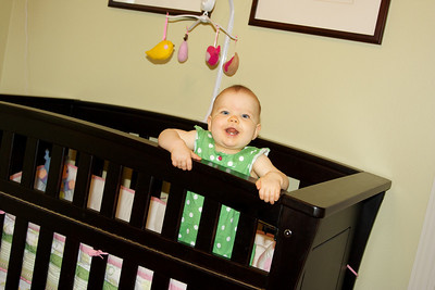 Look who can pull up in her crib…!