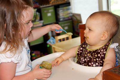 Anna loves to help feed Ellen