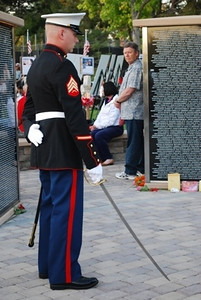 Sgt. Sam Lynn in the Memorial awaiting the start of the reading of the names of the latest heroes.