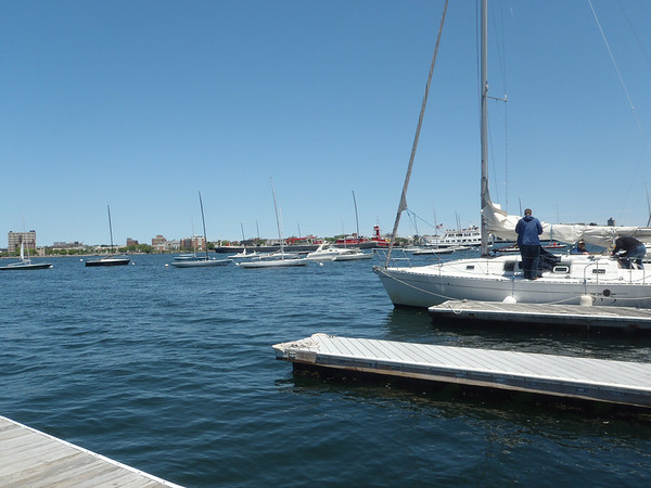 From the dock of the Boston Sailing Center - a largish commercial ship and a harbor cruise boat passing by.