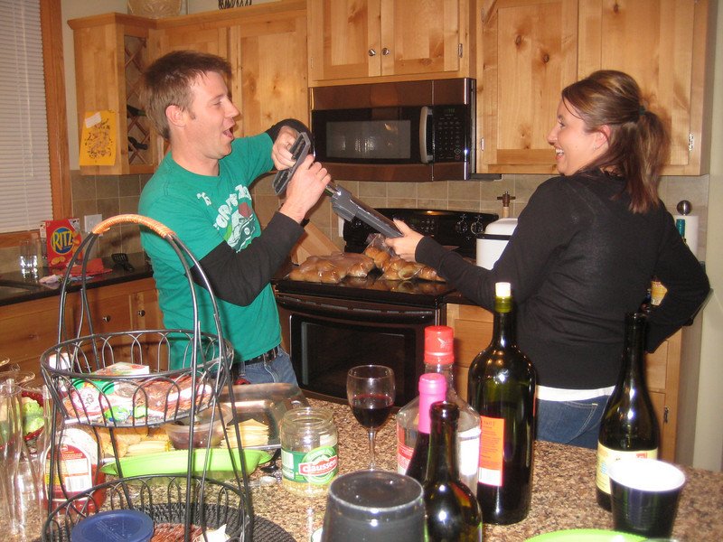 Cleaning up the wine glass Jason chucked across the kitchen.