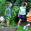 Ainsley, Emily, and Anna playing hide-and-go-seek
