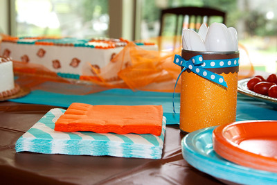 Cute utensil holder out of a soup can and scrapbook paper