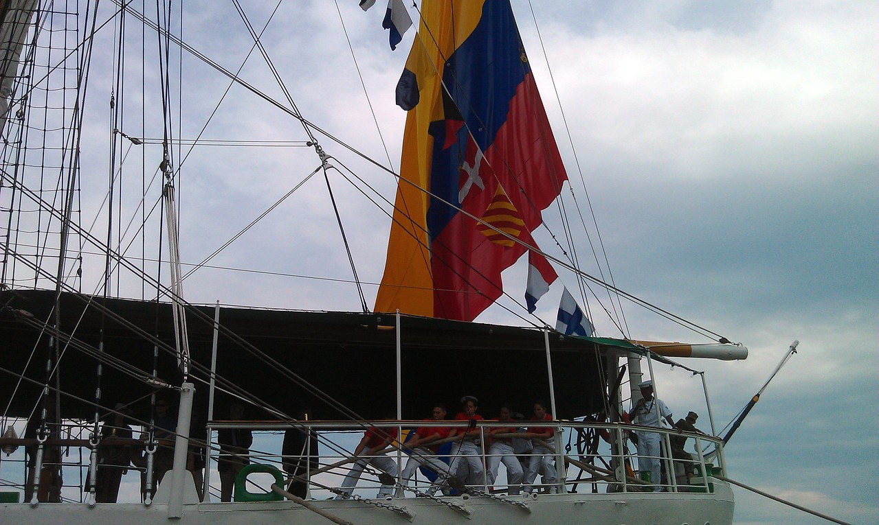 The ARC Gloria, docked at Robinson Terminal South.  The large flag is the Naval Ensign of Colombia.