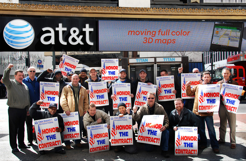 CWA 1101 Members, with VP Joe Manley (on the left in grey) and Secretary Jim Trainor (on the left in blue), tell AT&T Mobility to 'Honor The Contract'.