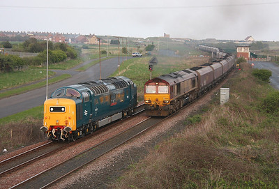 55022 Freemans Crossing 19/04/11 waiting for 66094 to pass with 6E42 to Cottam Power Station before returning to North Blyth to stable for the night.