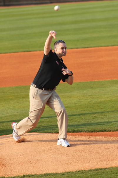 Men's Basketball Coach Chris Holtmann through out the first pitch before GWU's game against Charleston Southern.