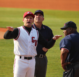 Coach Rusty Stroupe speaks with the officials before Gardner-Webb's match-up against Charleston Southern.