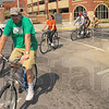 Tribune-Star/Jim Avelis<br /> Here they come: Vigo County School administration officials rode bikes from Otter Creek Middle School to the Downtown office as part of the March Of Dimes fundraiser.