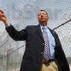"Stun fence: Jim Basinger, director of adult facilities at the Wabash Valley Correctional Facility explains the workings of the newly installed ""stun fence"" at the prison Thursday afternoon."