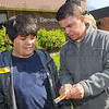 Tribune-Star/Jim Avelis<br /> Teaching moment: Deming Elementary School student Gabe Fisher listens to his mentor Chris Burson explain the care needed to keep the schools' new tree strong and healthy. Burson, A GE Aviation employee, was one of several mentors on hand for the planting of an eastern redbud Thursday morning.