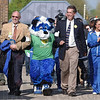 Tribune-Star/Jim Avelis<br /> Good company: Indiana State University president Dan Bradley and Terre Haute mayor Duke Bennett escort the latest incarnation of Sycamore Sam to the Earth Day festivities Thursday morning at Dede Plaza on the ISU campus.