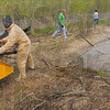 Tribune-Star/Jim Avelis<br /> Daily grind: Terre Huate City Parks Department employees Pam Pell and Charles Natt of the Indiana Air National Guard feed brush and limbs into a chipper at the new city park at 5th and Maple streets. Volunteers from Starbucks and other organizations spent part of Thursday helping get the park ready for use.