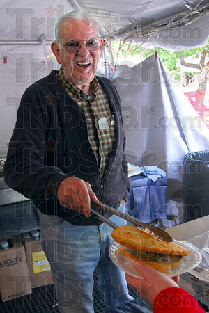 Happy to help: Oberlander Club member Jerry Keyes makes a sandwich for a lunch patron Thursday as the annual Strassenfest Event opens. Hours for Thursday and Friday are from 11:00 to midnight, 4:00 to midnight Saturday.