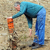 Tribune-Star/Jim Avelis<br /> Maintenance work: Phil Cater cleans accumulated field debris from one of the pipes in a field near his home. The terraced field is tiled, helping it dry out more quickly.