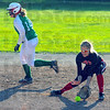 Tribune-Star/Jim Avelis<br /> Sure hands: Brave shortstop Kelsey Marlow stops a groundball in late action against North Central Thursay eveing at the THMSA fields.