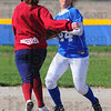 Tribune-Star/Jim Avelis<br /> Only one: Rox secondbaseman Hillary Woodard(24) forces Panther baserunner Miranda Dressler out at second, but has no play at first on a fielders' choice.