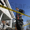 Investigator: Fire department investigator Jeff Hodges surveys the scene of an early morning fire at 1026 N. 9th Street Thursday.