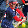 Tribune-Star/Jim Avelis<br /> Contact: Hailee Travioli raps out a hit for the Patriots in their game with Sullivan Thursday evening.