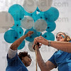 Release: Mia Lewis and Kristine Hansen release balloons during the sexual assault awareness event on Dede Plaza Thursday afternoon.