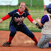 Tribune-Star/Jim Avelis<br /> Stopped: Terre Haute North shortstop Marlee Yeager puts the tag on Sullivan baserunner Tori Stamper lat in their Thursday game on the Golden Arrows diamond.