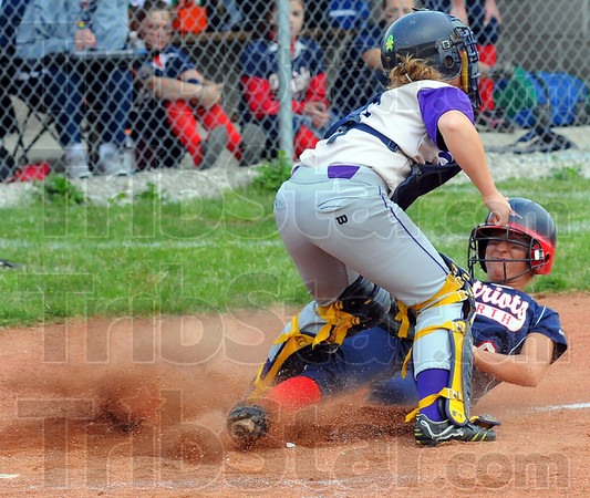Tribune-Star/Jim Avelis<br /> A little short: Patriot baserunner Paige Collins can't get past Golden Arrow catcher Allexis Mahurin how tags for for an out.