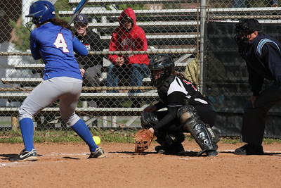 Catcher, number 17, McKenzie Morenus positions herself to catch the pitch.